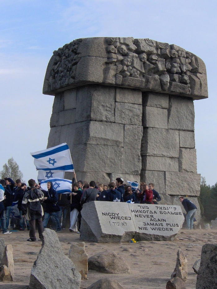 Highschool studants waving israeli flags in Treblinka extermination camp as part of the Holocast remembrance trip to Poland