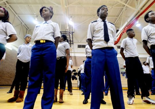 Asia Burns, left, and Arlonzo Chism stand in formation during ROTC at Woodlawn High School. (Photo: Henrietta Wildsmith/The Times)