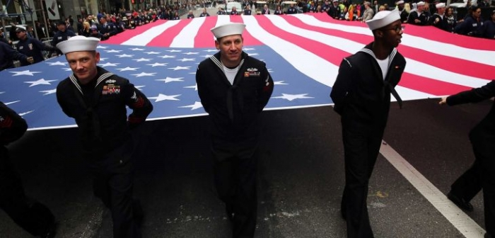 "NEW YORK, NY - NOVEMBER 11: Members of the U.S. Navy march with the American Flag in the the nation's largest Veterans Day Parade in New York City on November 11, 2015 in New York City. Known as ""America's Parade"" it features over 20,000 participants, including veterans of numerous eras, military units, businesses and high school bands and civic and youth groups. (Photo by Spencer Platt/Getty Images) (Credit: Getty Images / Spencer Platt)"