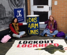 Student activists blockade a door at the University of Melbourne