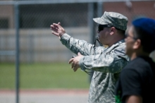 A Soldier with the 1st Battalion, 12th Cavalry Regiment, 3rd Armored Brigade Combat Team, 1st Cavalry Division referees a flag football game at Shoemaker High School during an organization day for the Junior Reserve Officer Training Corps cadets at Killeen, Texas, May 29. Soldiers helped organize the events, referee games, and foster a safe environment. (U.S. Army photo by Sgt. Brandon Banzhaf, 3rd Armored Brigade Combat Team, 1st Cavalry Division)