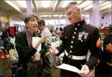 Amy Hagopian, co-chairwoman of the Garfield High PTSA, lights up Marine Sgt. Christopher Matthews in the school lunchroom. Hagopian is trying to get military recruiters barred from the school. The Marines and the Army have failed to meet recruiting quotas in recent months. Photo: Dan DeLong/Seattle Post-Intelligencer